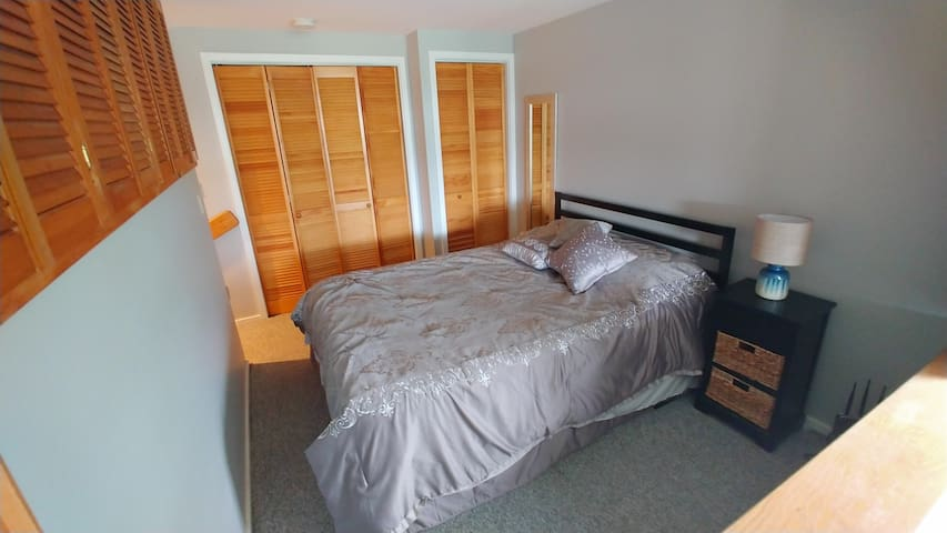 Bedroom with plenty of of storage space for belongings. Washer/dryer in closet