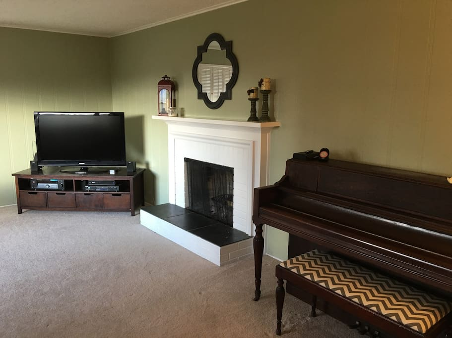 Wood burning fireplace in family room.
