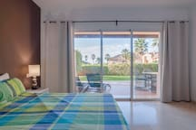 Master bedroom,leads out onto terrace,gardens and pools.