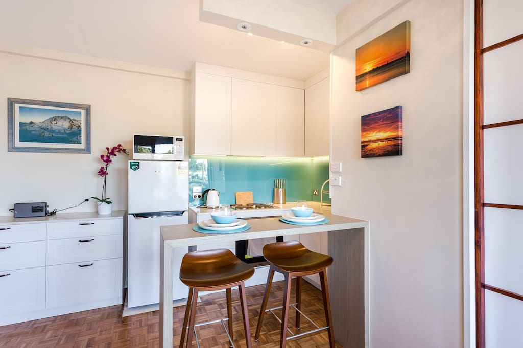 Full kitchen and breakfast bench that looks out across the park to St Kilda Pier