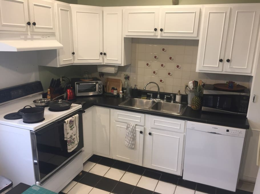 Full Kitchen with an island, double sink, toaster oven, french press and dishwasher.