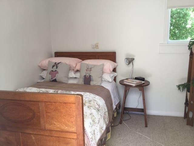 3/4 bed in little back bedroom, ensuite bathroom adjacent.