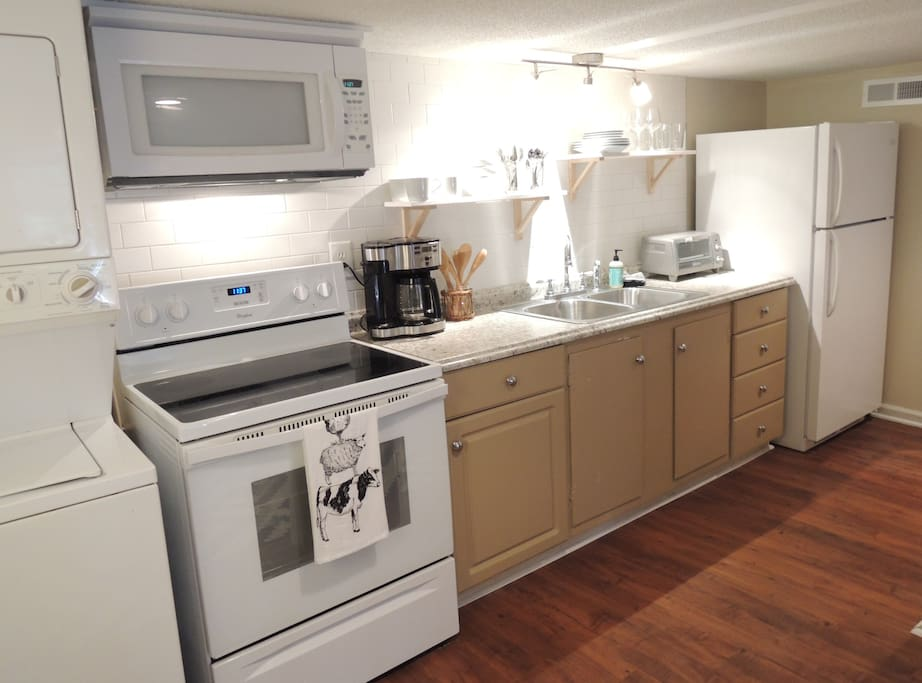 European style kitchenette with smooth top stove, microwave, full size fridge, toaster oven & coffee maker