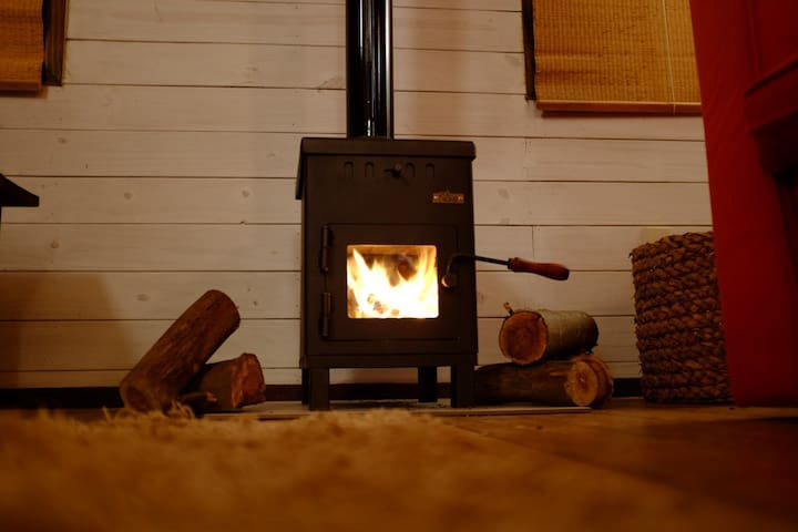 Relax and read a book by the log fire (for the adventurous you can gather your own firewood in the forest ;-)