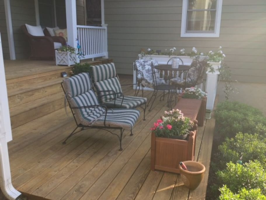 Enjoy deck with lounge chairs and dining table