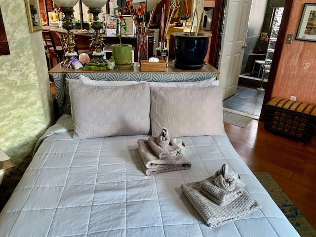 Queen sized bed invites a restful repose...for one or two.