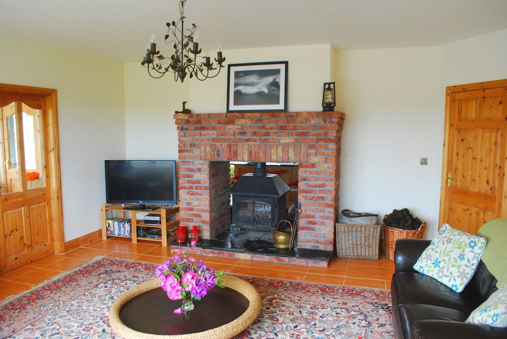 Spacious lounge area with double sided stove, large HDTV and wonderful views over Bunnagippaun lake.