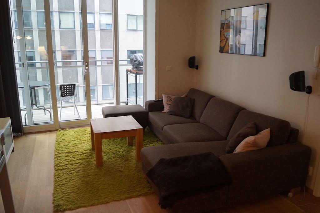 Nice living room with a balcony outside.