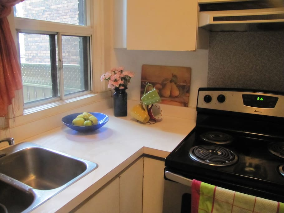 Galley kitchen with full size stove