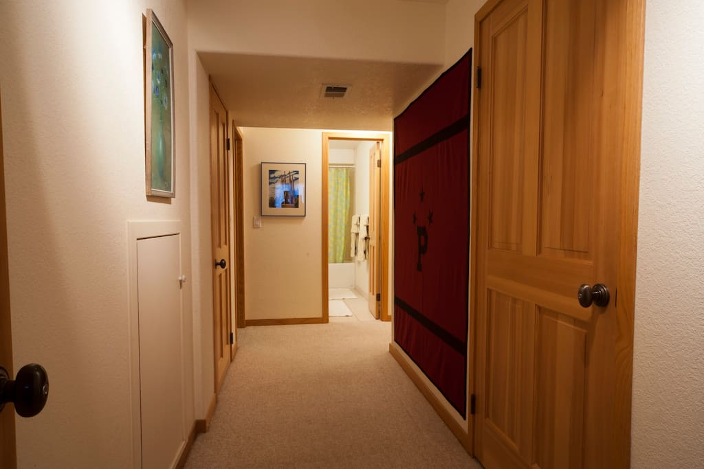 Your room is down a private hallway, to the right of the bathroom is a laundry room