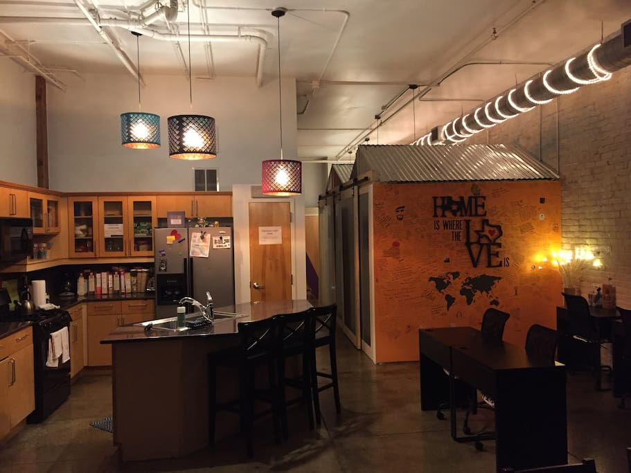 This is what you will see when you enter the loft....lots of room to work, a fully stocked kitchen, and an Alexa enabled speaker to provide some good vibes!