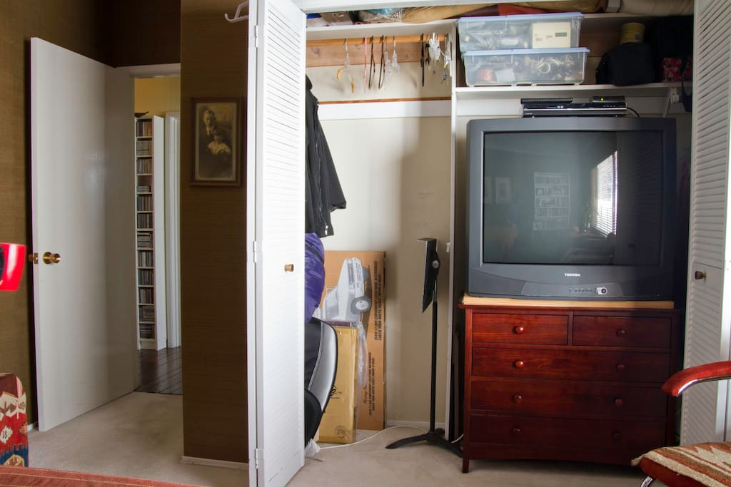 Empty chest of drawers and hanging space for your gear with big TV
