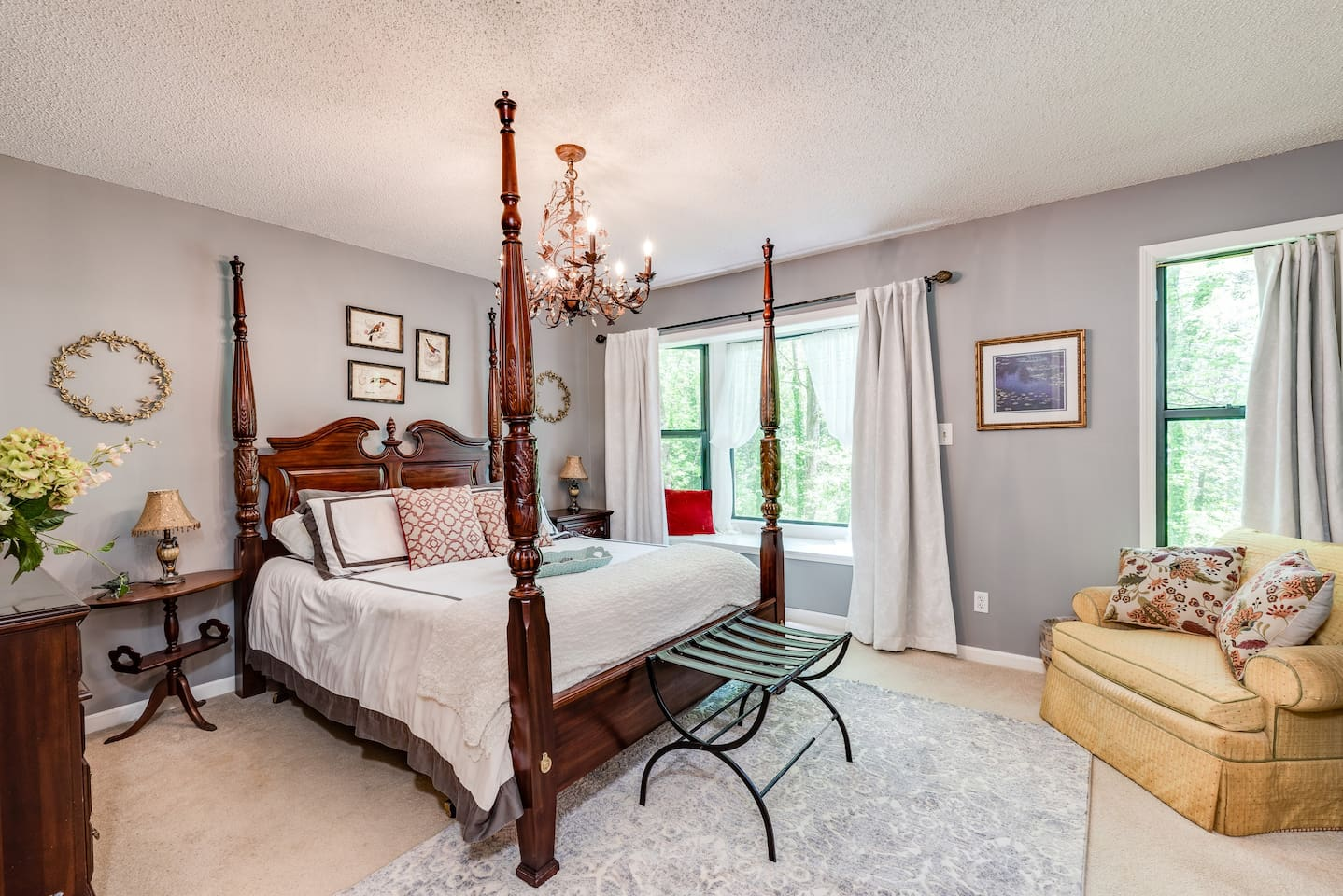 Our exquisite master suite with window seat which overlooks the woods. When it rains, a small brook and waterfall appears.