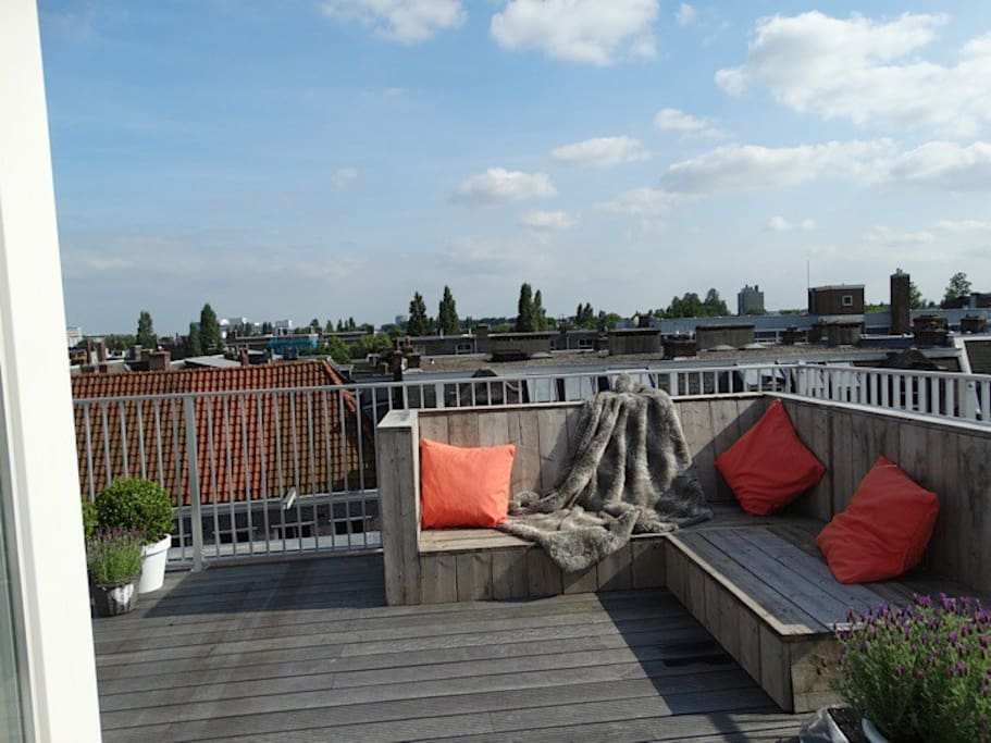 40m2 roof terrace with large comfy couch to relax on.