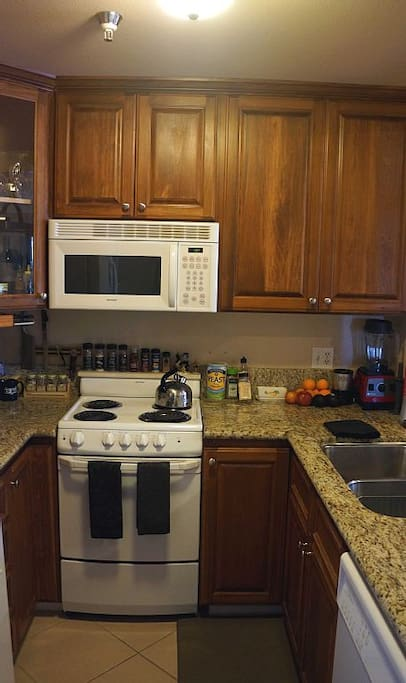 Nice Kitchen with granite counter tops and appliances.