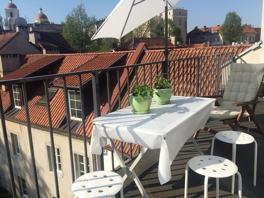 You can go to the balcony directly from your room. Enjoy nice view of Vilnius' Old Town ! Smoking is allowed on the balcony.