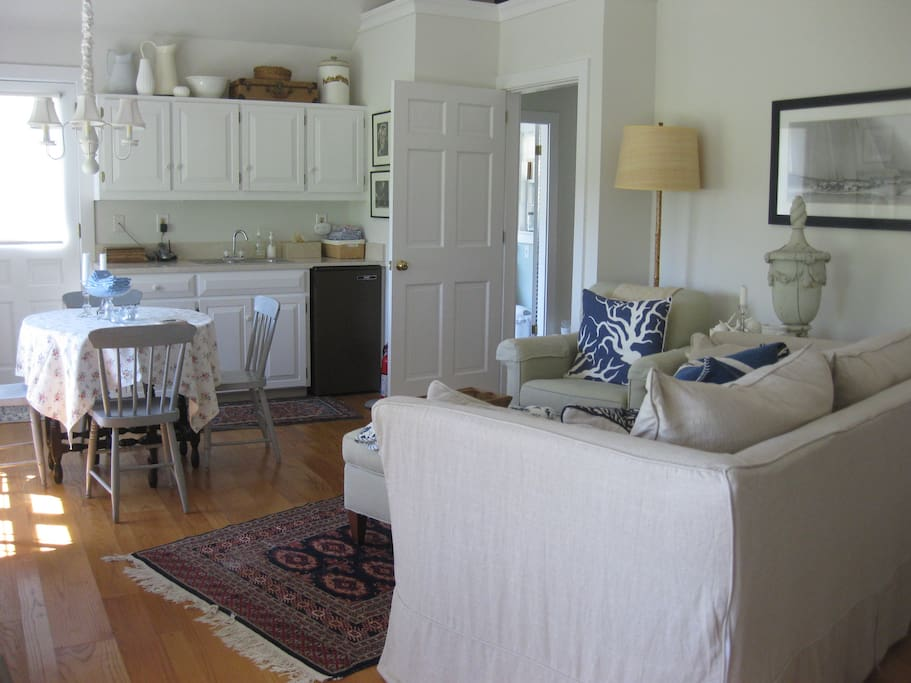 Great room also has a wet bar, small dining area and television.