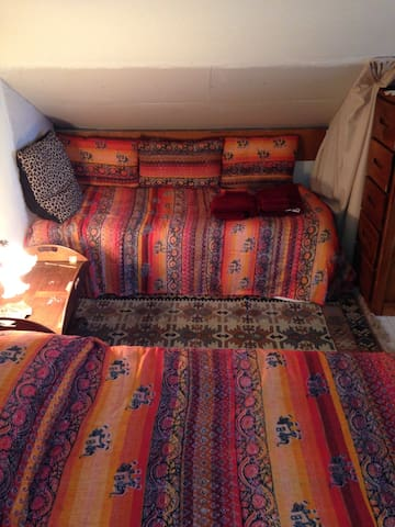 Twin bed next to queen bed