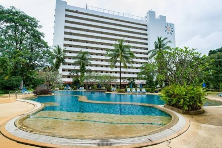 Nice swimming pool on ground with open space and garden to enjoy fresh air. The biggest swimming pool compound in Patong.