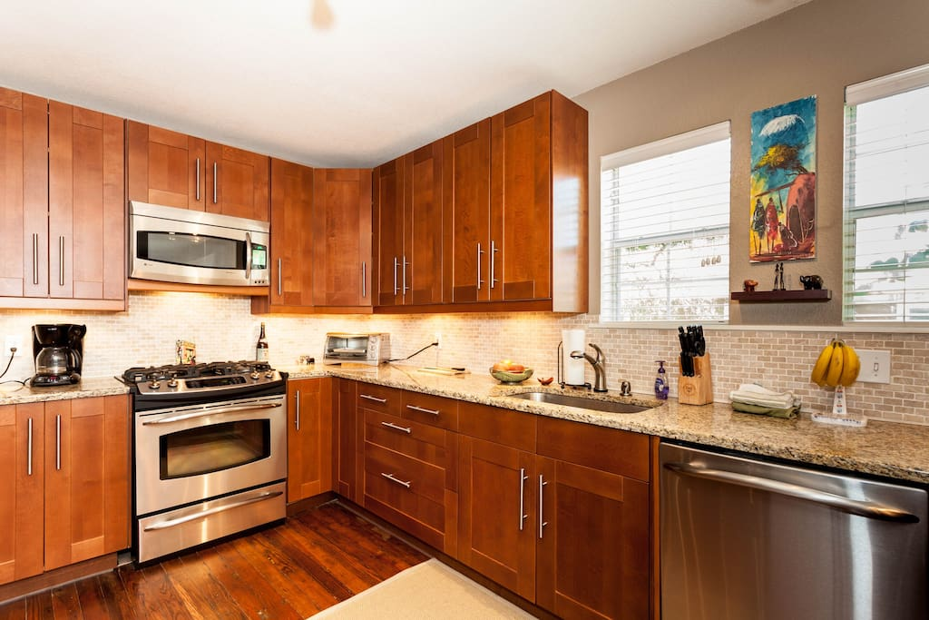 Renovated kitchen with stainless appliances including dishwasher
