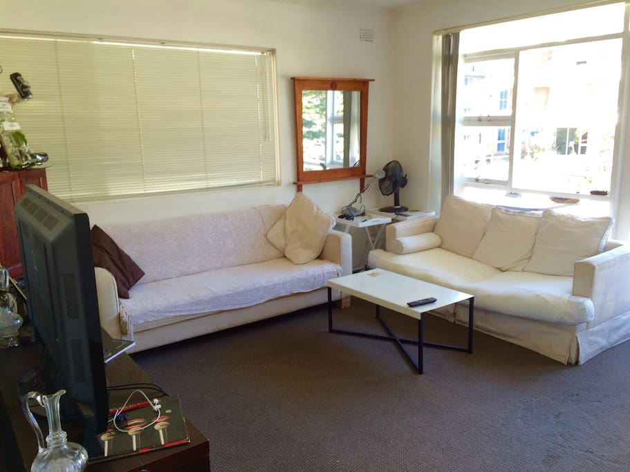Lounge Room with Two Double Sofas and Large Screen Plasma TV