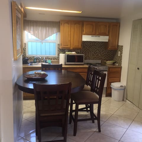 Fully equipped kitchen - cooking serving items, microwave, coffee maker, toaster