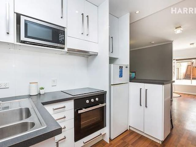 The kitchen has an oven, cooktop and microwave, all kitchen utensils, glassware and crockery.