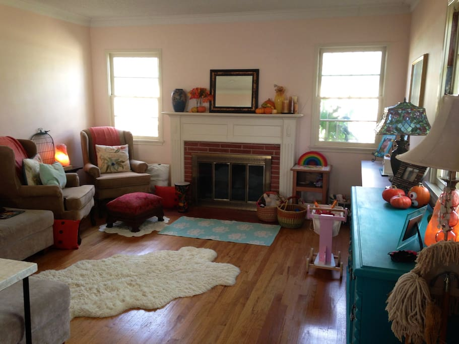 Our lovely, spacious living room with working fireplace and all. We have plenty of wood too! And seating for many!