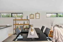 Dining table seats 6 people in an open plan setting