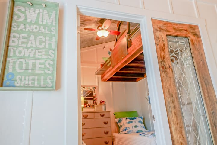 Stand at the upstairs window & look out at the beautiful Choctawhatchee Bay. This upstairs bunk room features 3 XL Twin beds (two lower, one bunk) and lowers convert to a KING! All beds are memory foam, and have protectors and 100% cotton linens!