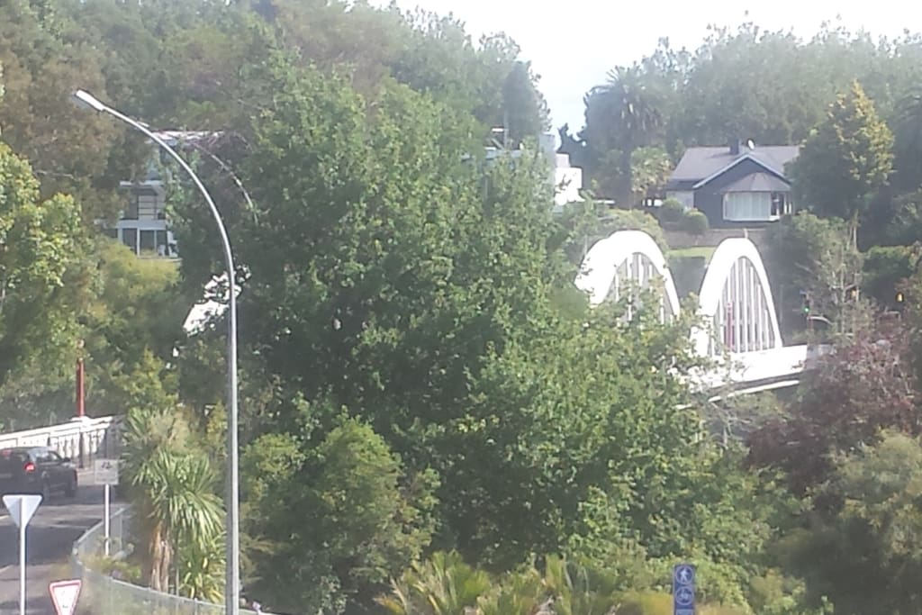 Day view from the Alfresco patio of the Iconic Fairfield Bridge/Waikato River that meets Victoria street/CBD