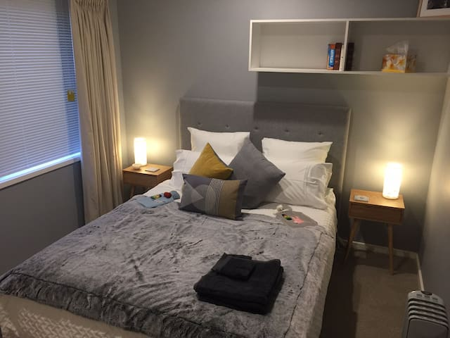 Comfortable queen sized bedroom with tv  and cosy comfortable topper on mattress and brand new cosy Doona /pillows and Sheridan linen !! Zzzzzzz