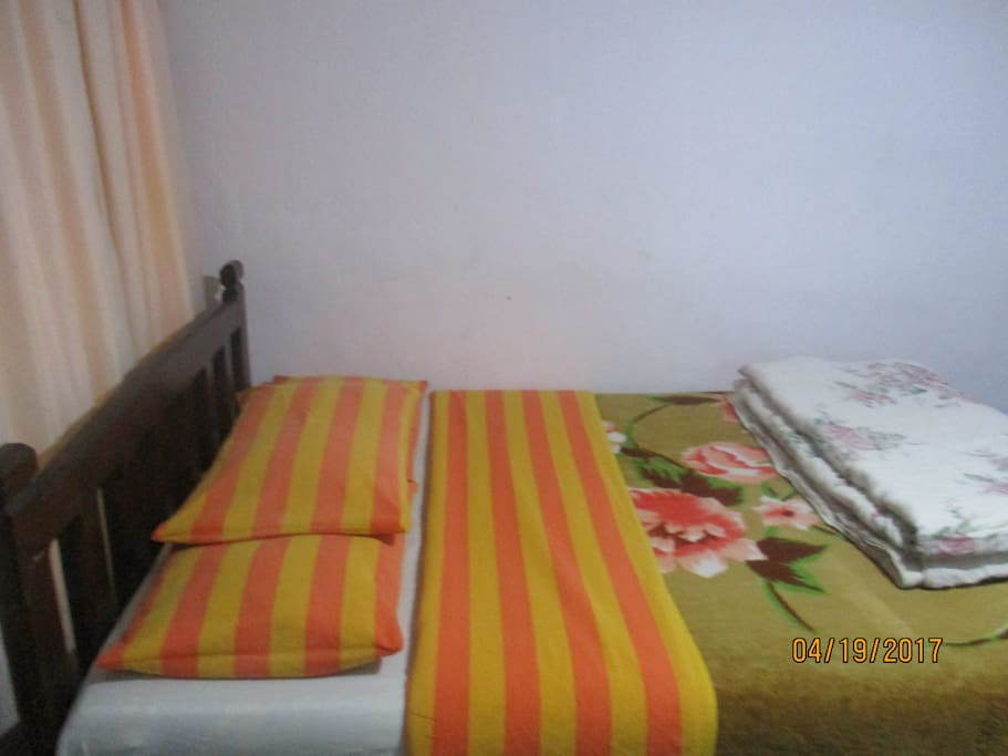 Room No. 3 with one double bed with a private tiled bathroom with hot water shower.