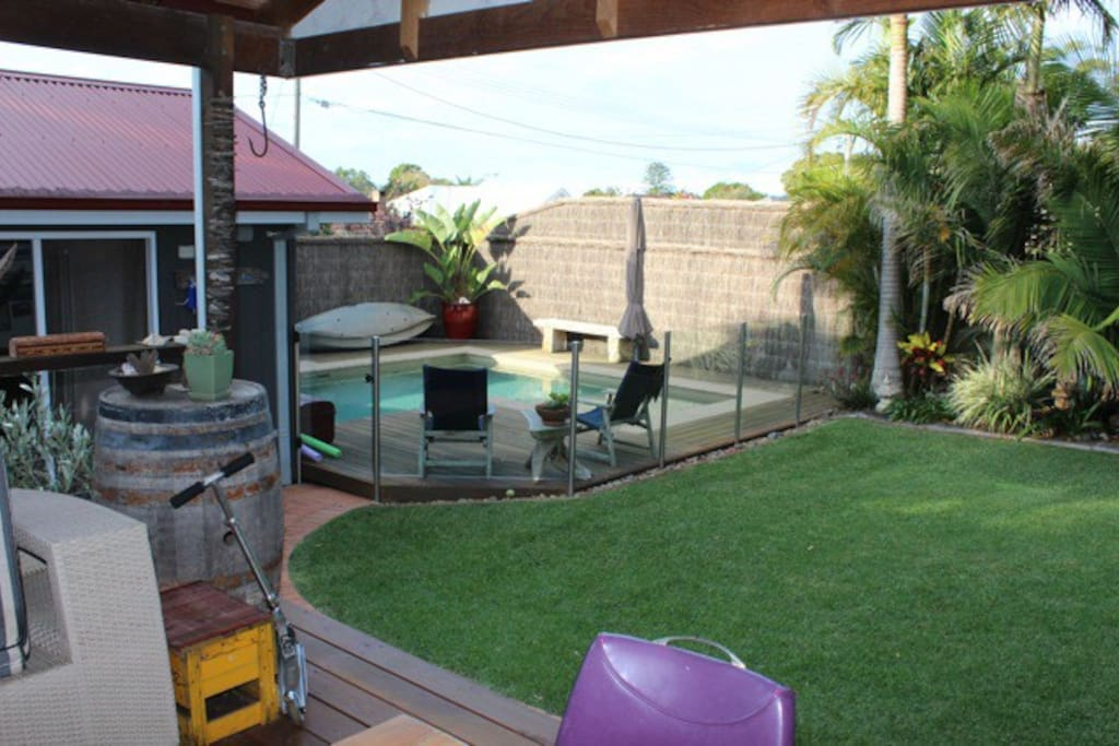 Private Back Yard with Pool and Lawn Area