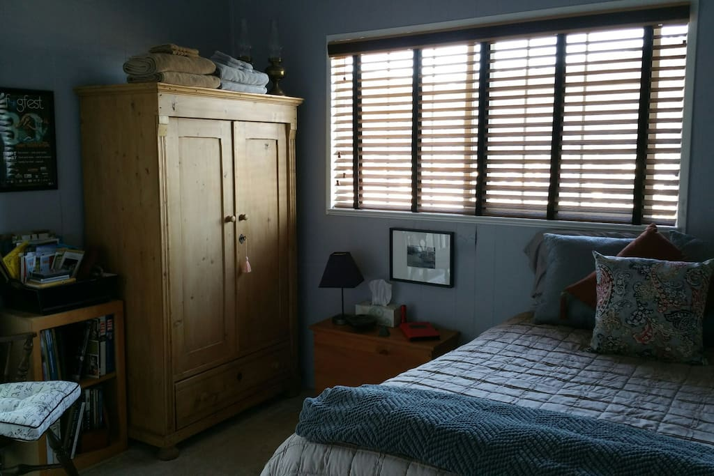 Bedroom #1 , double bed with access to patio and side parlor room.