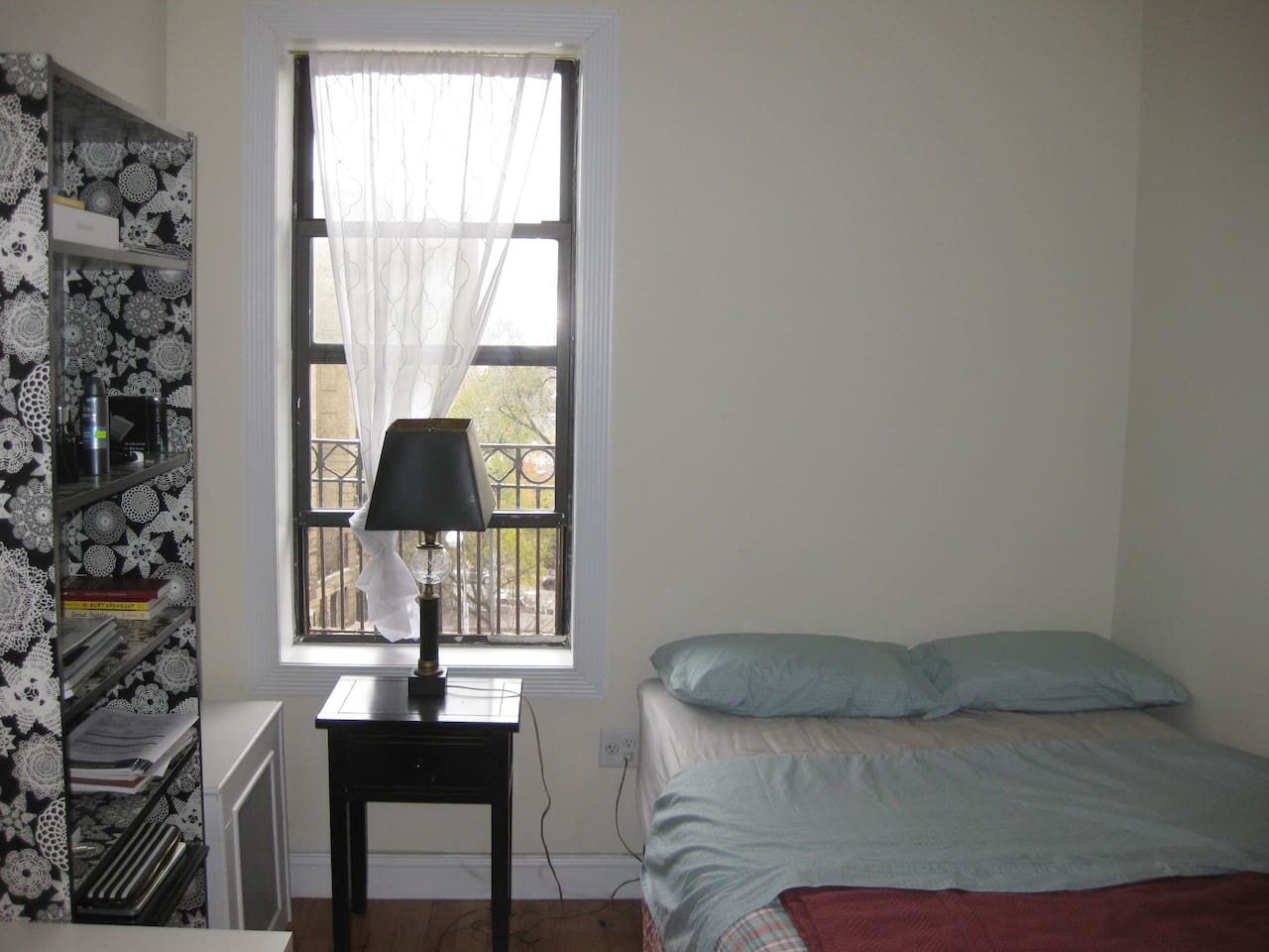 spacious room with lots of light and a full size bed