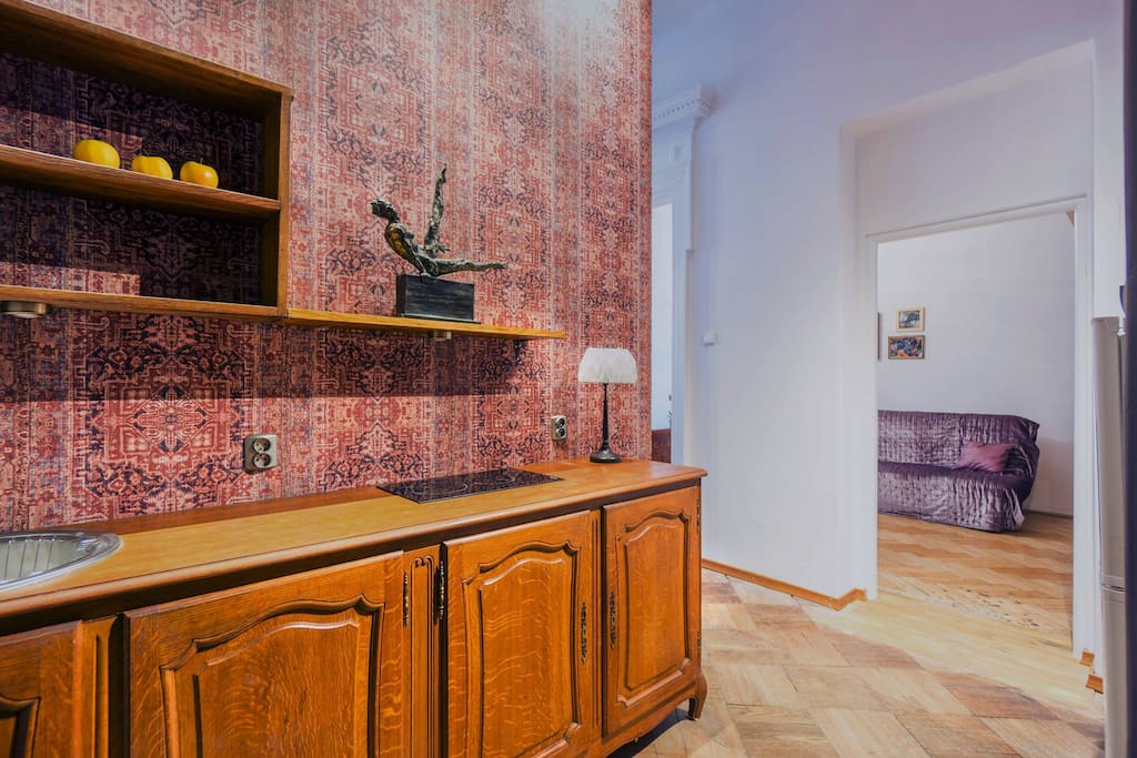 Kitchenette and view of a smaller room