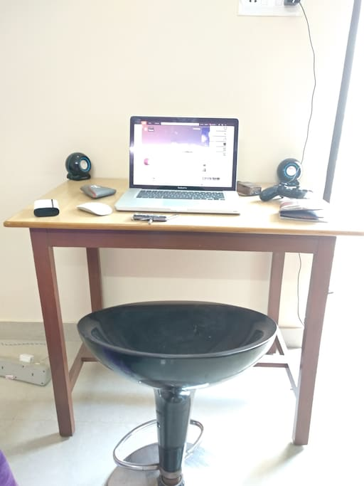 a work station in case one is on a business trip or is just a stubborn workaholic.