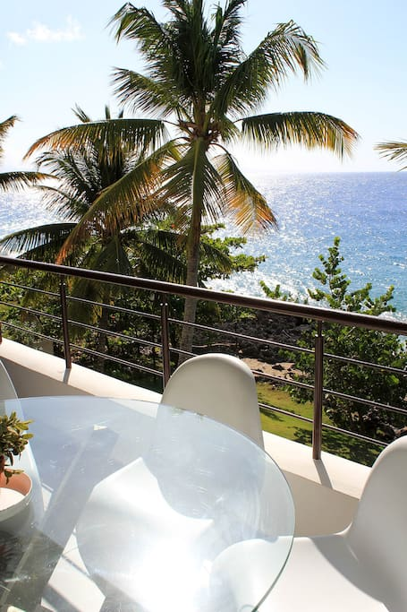 View of beach from outdoor dining room (you have both a rocky beach and a sandy beach!)