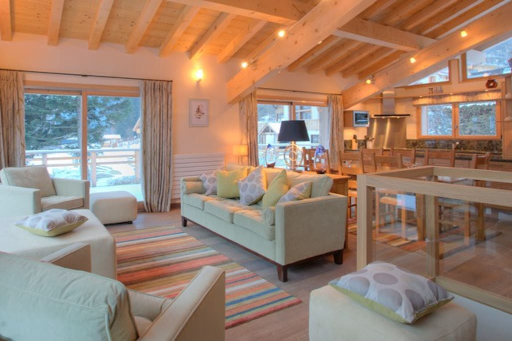 Open plan living area with natural timbers throughout