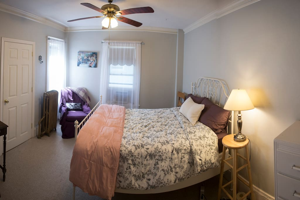 Guest room. Full sized (double) bed. Desk space, reading chair, closet space.