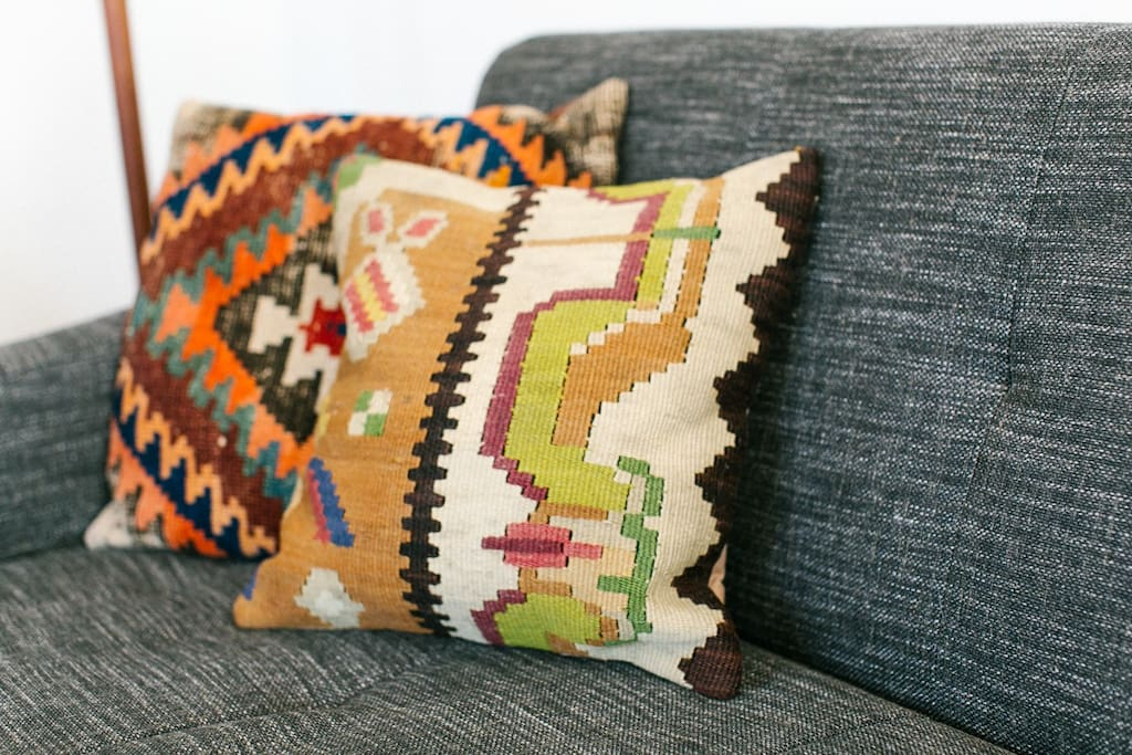 There are pillows and blankets for getting comfy on the couch.