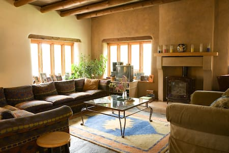 Revel in the real New Mexico at our historic adobe on the banks of the Santa Cruz River  north of Santa Fe. Our location is central to all the amazing sights & scenes of Northern New Mexico. We would love to share our part of the world with you!
