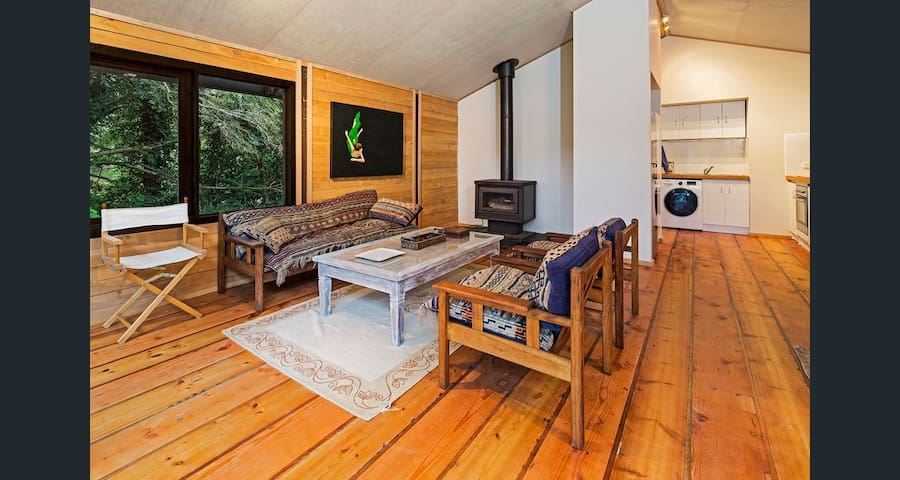 Loungeroom with wood heater & flooring milled from the property. Country style furniture adorns the space creating a cosy and warm environment.