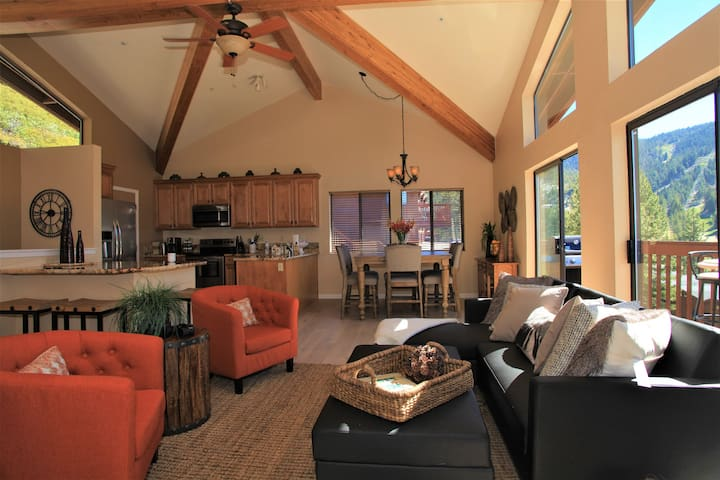 Cozy great room on upper level offers a spacious floor plan for relaxing or entertaining.  The black leather sleeper sofa easily converts to a comfortable full size bed.