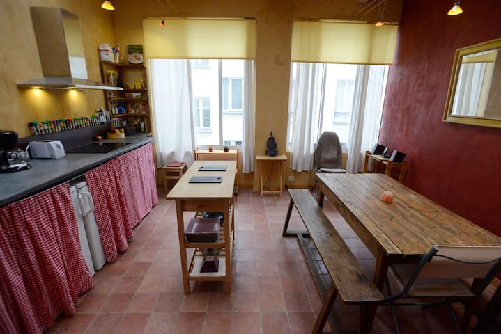 The fully equipped kitchen with large windows and sky lights.