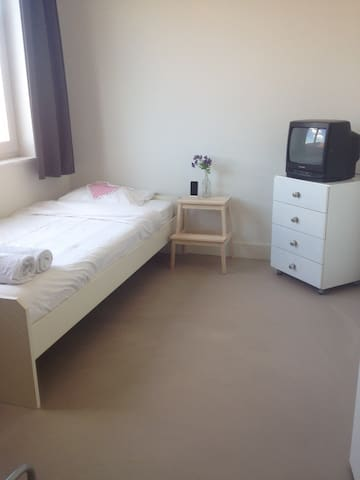 This is your private bedroom with a single bed. It's possible to add an other single bed. Tv is not working yet.