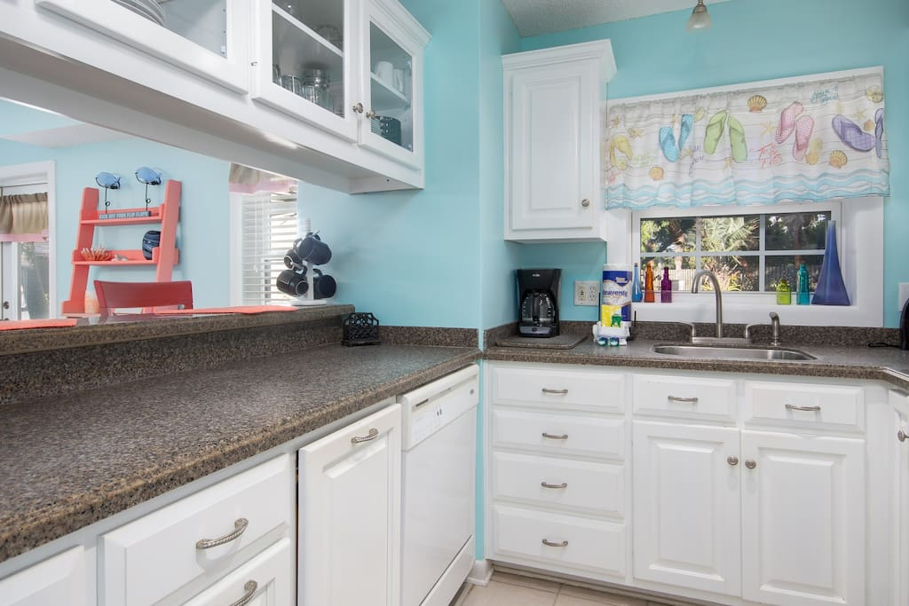 Dinners will be made with love in this galley-style kitchen, which opens to the main living space