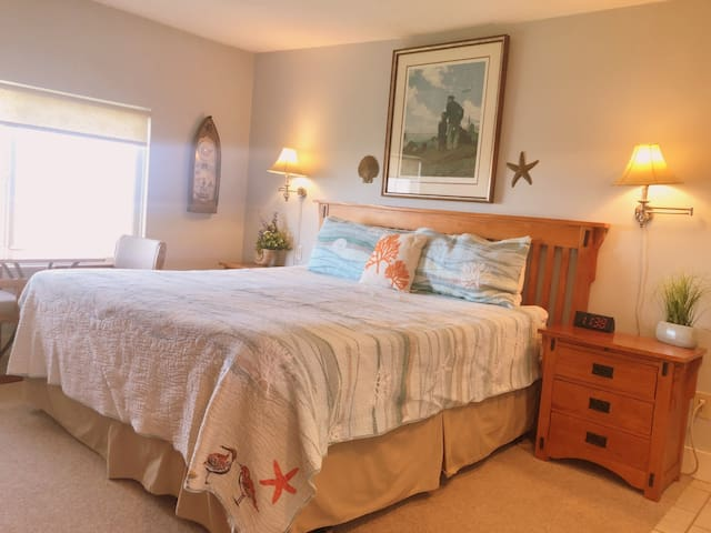 King bed and beach decor throughout