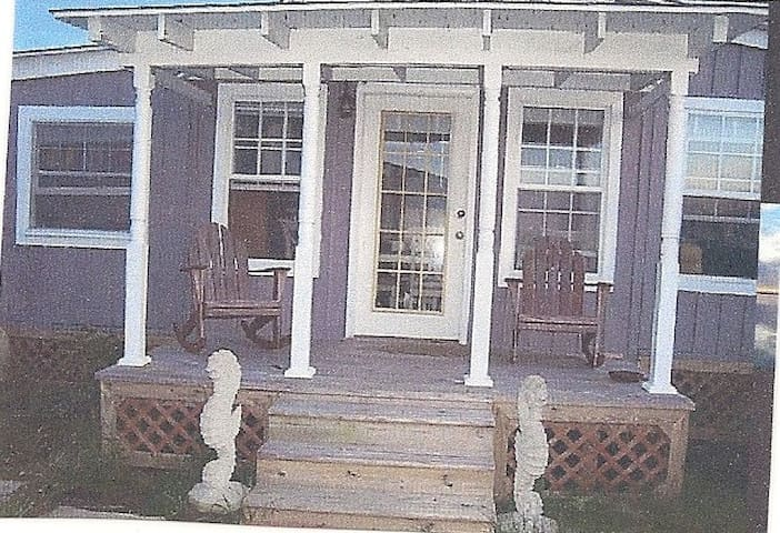 the front porch of the cottage for sipping coffee or a glass of wine